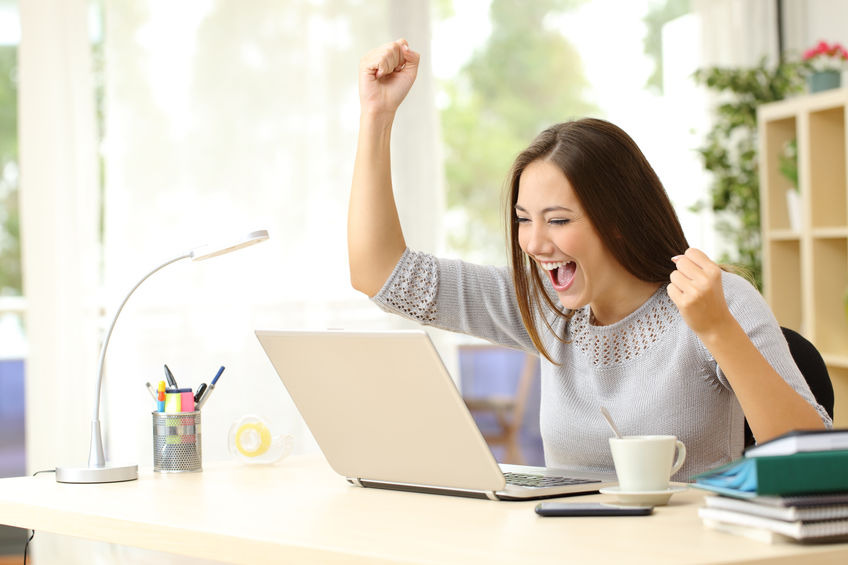 woman raising hand at her business success
